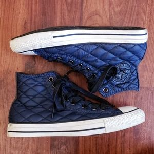 Converse navy high top Chuck Taylor sneakers